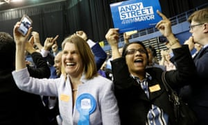 Supporters of the new mayor of the West Midlands, Andy Street, celebrate.