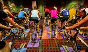 Members of Full-on Tri ride their bikes