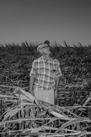 Robert Miller, who is 88 years old has been farming this land for nearly 40 years. Last week a derecho storm destroyed the majority of his corn crop. He has been without electricity for twelve days and says he'll be lucky if he can salvage even 25 percent of his corn fields. Wednesday, August 19th, Newton, Iowa. Photo by Jordan Gale