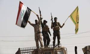 Members of Iraqi Shiite Hasdi Sabi regiment celebrate after they recaptured Fallujah's Saklaviye district from Islamic State .