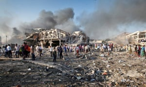 Somalis gather and search for survivors by destroyed buildings in the truck bombing in Mogadishu in October.
