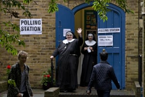 Nuns leave after casting their votes at a polling station in London