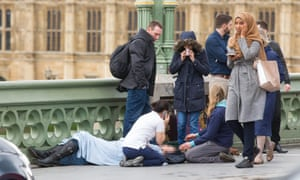 Woman visibly distressed passing the scene of the terrorist incident on Westminster Bridge