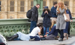 A woman in a headscarf passes the scene of the terrorist attack on Westminster Bridge in March. Russia-run accounts tried to stir anti-Islamic sentiment by falsely claiming she had ignored victims.