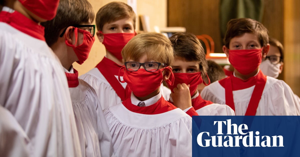 A swimwear show and masked choristers: Friday's best photos - The Guardian