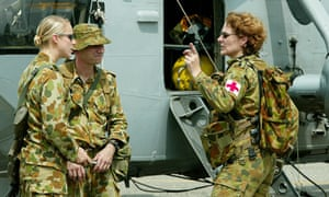 Two female members of the Australian Defence Force with a male colleague
