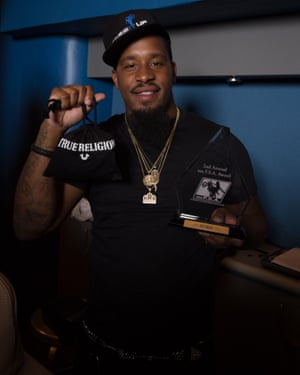 Baltimore's Lil Steve holds up his award for best swerve and his True Religion gift bag. The awards show had a number of sponsors