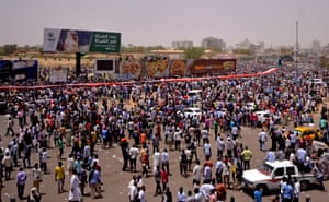 Crowds gather after Sudan's defence minister and army general, Ahmed Awad Ibn Auf, announces that President Omar al-Bashir has been detained and that a military council will run the country.