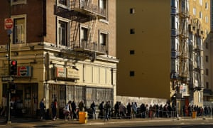A line of homeless people waiting for a meal at Glyde Methodist church in the Tenderloin, San Francisco.