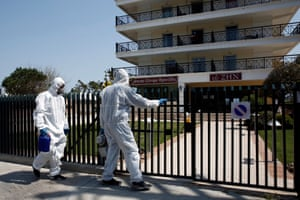 A disinfecting crew enters a retirement home in Nea Makri, east of Athens, Greece