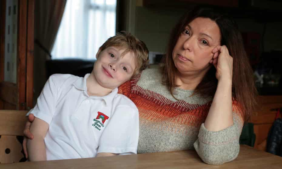 Luis Walker, who has cystic fibrosis, sits with his mother Christine. She has been campaigning to get her son the Orkambi drug.