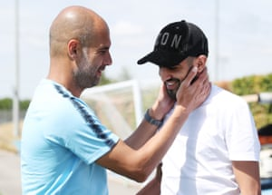 Manchester City's new signing Riyad Mahrez is greeted by manager Pep Guardiola on his first day.