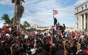 Rapper Bad Bunny, singer Ricky Martin and rapper Residente join demonstrators protesting against Ricardo Rosselló, the governor of Puerto Rico.