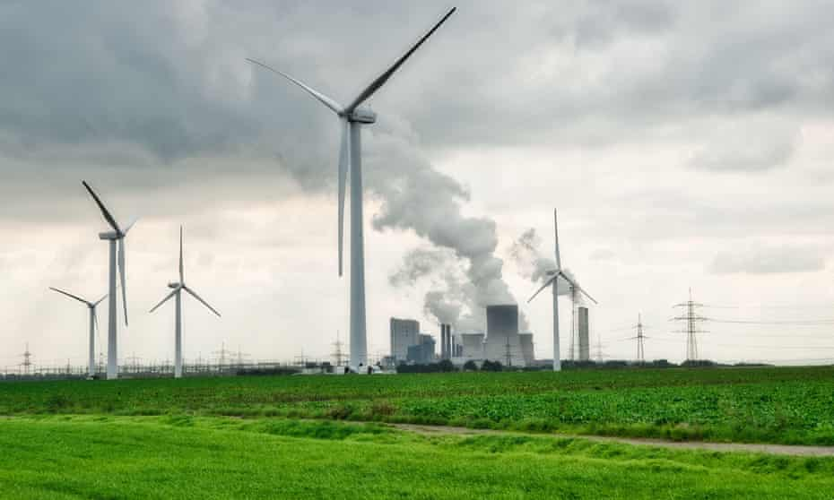 Wind turbines and coal power plants in Bergheim, Germany.