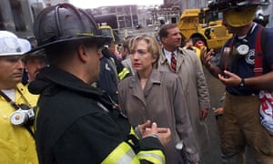 Hillary Clinton listens to firefighters during a tour of the World Trade Center disaster site in September 2001.