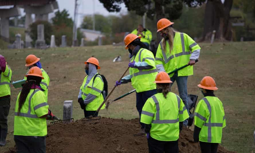 A team of forensic archeologists excavate a suspected mass grave site at Tulsa's Oaklawn cemetery.