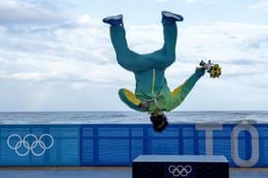 Brazilian surfer Italo Ferreira celebrates in style after taking gold in the men's shortboard