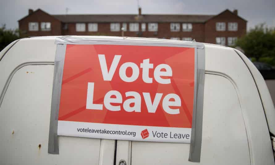 A small white van with a 'vote leave' sign stuck to it with silver tape
