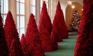 Trees made from red berries line the East Colonnade at the White House.