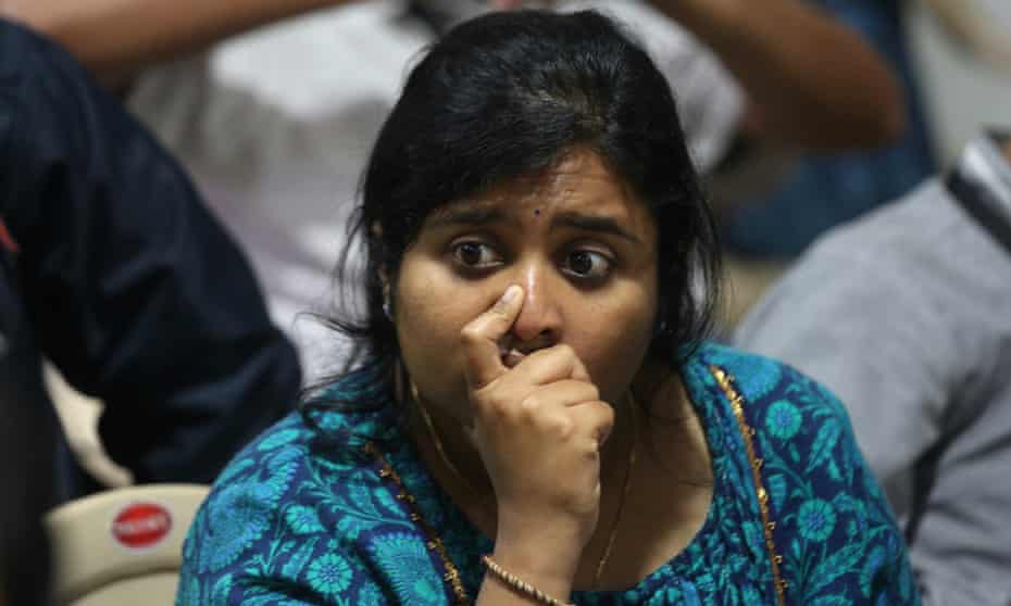 An ISRO employee reacts after the communication and data were lost from the Vikram Lander.