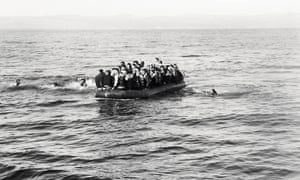 Refugees arrive at Lesbos. An overcrowded boat of refugees heads to the shore