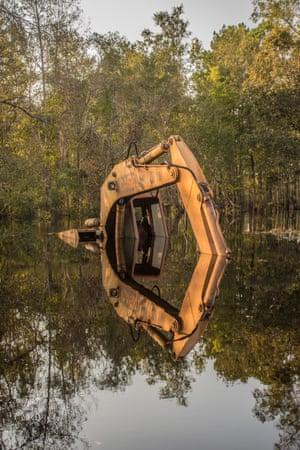 Construction equipment lies semi-submerged in Burgaw, North Carolina