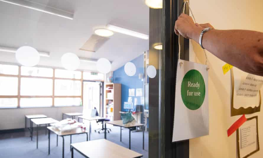 A sign is placed outside a disinfected classroom at Queen's Hill primary school in Costessey, Norwich.
