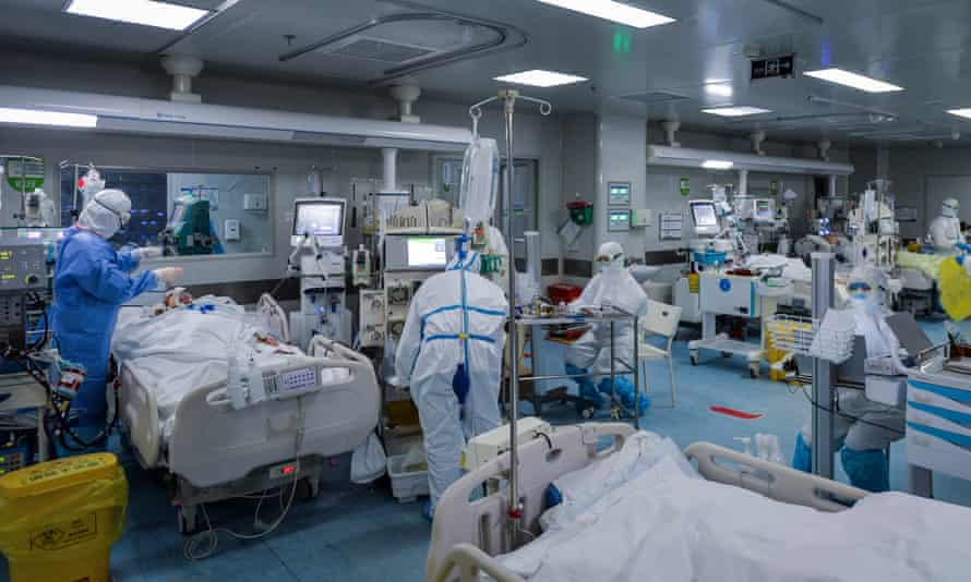 Medical personnel work in the intensive care unit (ICU) of a hospital designated for COVID-19 patients in Wuhan, Hubei province, China