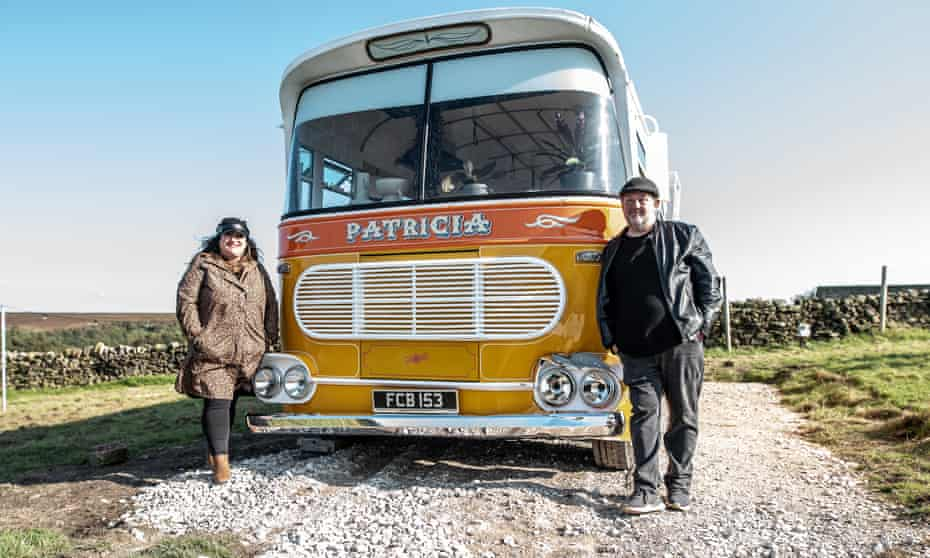 Johnny Vegas and Bev, his assistant and friend, with the bus he named after his mother, Patricia.