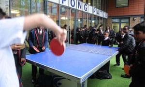 boys playing ping pong