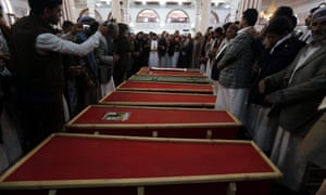 Mourners pray by the coffins of a senior Yemeni judge and his family killed in a Saudi-led airstrike.