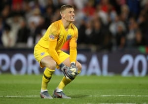 England's Jordan Pickford reacts after conceding their second goal.