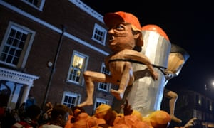 An effigy of Donald Trump is paraded through the streets.
