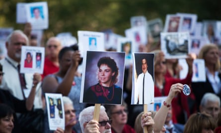 Family members of people killed by drink drivers hold pictures of their loved ones during a Mothers Against Drunk Driving rally in Washington DC.
