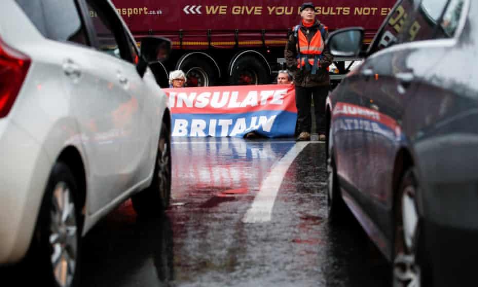 Insulate Britain activists block a motorway junction near Heathrow airport in London.