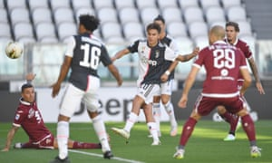 Paulo Dybala (centre) of Juventus scores the opening goal.