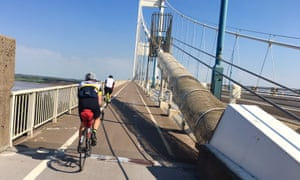 Riders cross back into England over the old Severn bridge.