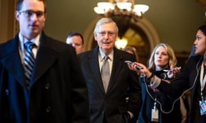 Mitch McConnell walks off the Senate floor in the Capitol in Washington DC on 22 January.