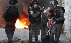 Israeli security forces arrest a Palestinian during clashes in the Palestinian neighbourhood of Shuafat in east Jerusalem as violence spiked in east Jerusalem and the occupied West Bank.