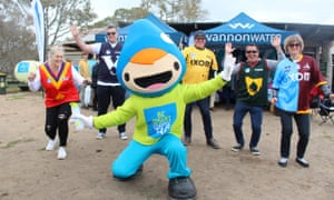 Finalists from five states pose with a mascot during the judging of Australia's best tap water