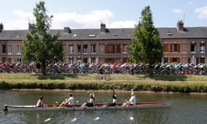 Rowers wave at the peloton at the start of the sixth stage.