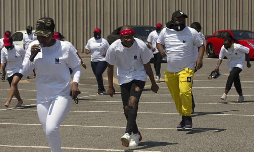 Artist, Master KG, center, and singer Nomcebo Zikode, left, sing and dance to Jerusalema in Johannesburg, September 2020