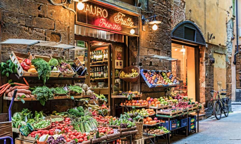 Fruit and vegetables are displayed outside greengrocer, Mauro Tratta in Florence