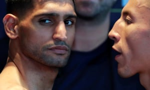 Amir Khan and Samuel Vargas face off at the weigh-in at Arena Birmingham on Friday.