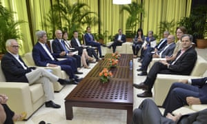 US secretary of state John Kerry, second from left, and US special envoy for the Colombian peace process Bernard Aronson, far left, meet with Colombia's peace commissioner Sergio Jaramillo, right; head of the Colombia's government negotiation team Humberto de la Calle, third from right; and other members of the Colombian government team.