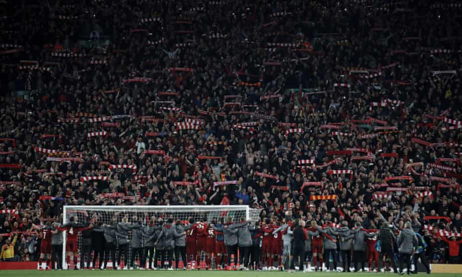 Jürgen Klopp with his Liverpool staff and players celebrate in front of the Kop after the Champions League semi-final victory over Barcelona on 7 May 2019.