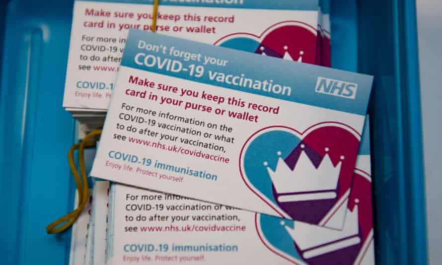 NHS Covid-19 vaccination cards.