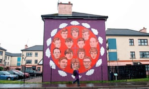A pedestrian walks past a mural honouring the victims of the 1972 Bloody Sunday killings in Derry.