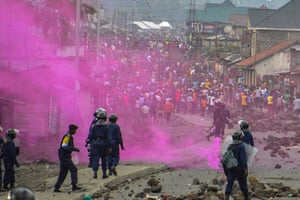 Fuchsia-coloured flares are launched by DRC police forces during a demonstration in Goma.