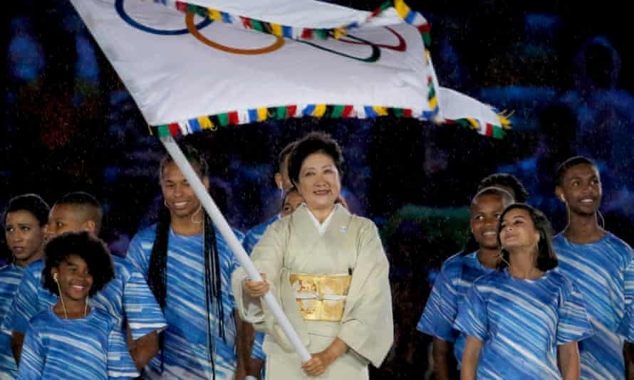 Tokyo's governor Yuriko Koike waves the Olympic flag during the Rio closing ceremony.